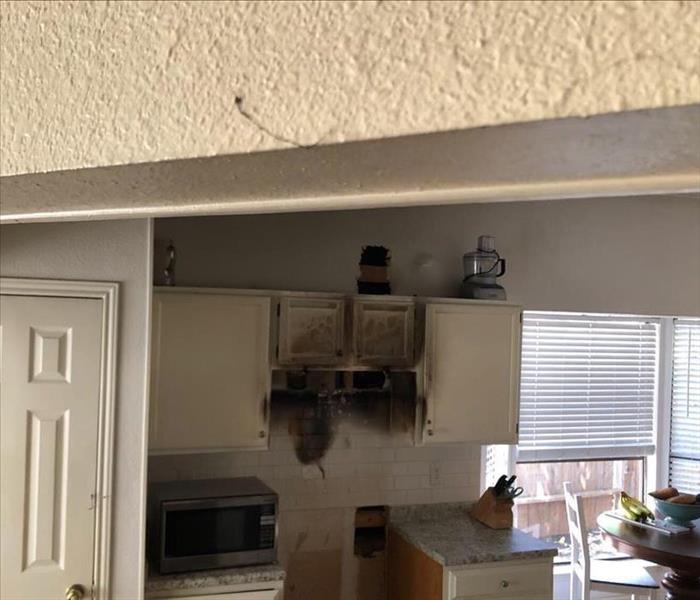 Burned / Soot Covered walls and cabinets aftermath of fire