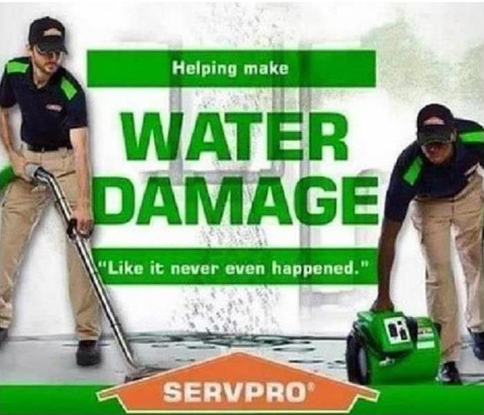 Two SERVPRO Employees cleaning up water damage